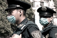 Police Officers don masks for protection.